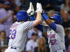ATLANTA, GA - SEPTEMBER 12: Yoenis Cespedes #52 of the New York Mets celebrates with Daniel Murphy #28 after hitting a solo home run in the eighth inning of the game against the Atlanta Braves on September 12, 2015 at Turner Field in Atlanta, Georgia. (Photo by Todd Kirkland/Getty Images) *** Local Caption *** Yoenis Cespedes, Daniel Murphy