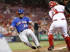 CINCINNATI, OH - SEPTEMBER 24: Daniel Murphy #28 of the New York Mets slides at home plate to score a run after a double by Lucas Duda in the third inning against the Cincinnati Reds at Great American Ball Park on September 24, 2015 in Cincinnati, Ohio. (Photo by Joe Robbins/Getty Images)