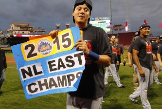 CINCINNATI, OH - SEPTEMBER 27: Wilmer Flores #4 of New York Mets celebrate after defeating the Cincinnati Reds 10-2 to clinch the National League East Championship at Great American Ball Park on September 26, 2015 in Cincinnati, Ohio.  (Photo by John Sommers II/Getty Images)