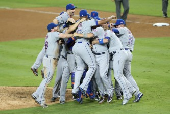 LOS ANGELES, CA - OCTOBER 15:  The New York Mets celebrate after the Mets 3-2 victory against the Los Angeles Dodgers in game five of the National League Division Series at Dodger Stadium on October 15, 2015 in Los Angeles, California.  (Photo by Stephen Dunn/Getty Images)