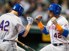 CLEVELAND, OH -  APRIL 15: Neil Walker #20 celebrates with Yoenis Cespedes #52 of the New York Mets after Cespedes hit a two run home run during the fifth inning against the Cleveland Indians at Progressive Field on April 15, 2016 in Cleveland, Ohio. All players are wearing #42 in honor of Jackie Robinson Day. (Photo by Jason Miller/Getty Images)