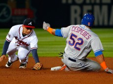 ATLANTA, GA - APRIL 22:  Yoenis Cespedes #52 of the New York Mets slides safely into second base against the tag attempt by Daniel Castro #14 of the Atlanta Braves in the seventh inning at Turner Field on April 22, 2016 in Atlanta, Georgia.  (Photo by Kevin C. Cox/Getty Images)