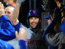 ATLANTA, GA - APRIL 23: Neil Walker #20 of the New York Mets is congratulated by teammates after hitting a ninth inning solo inning run against the Atlanta Braves at Turner Field on April 23, 2016 in Atlanta, Georgia. (Photo by Scott Cunningham/Getty Images)