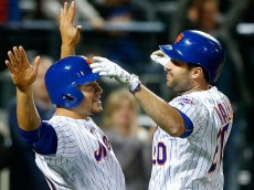 NEW YORK, NY - APRIL 25:  Neil Walker #20 of the New York Mets reacts after his seventh inning two run home run against the Cincinnati Reds with teammate Michael Conforto #30 at Citi Field on April 25, 2016 in the Flushing neighborhood of the Queens borough of New York City.  (Photo by Jim McIsaac/Getty Images)