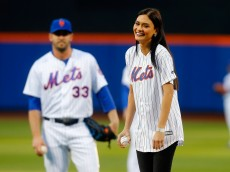 NEW YORK, NY - APRIL 27:  Miss Universe 2015 Pia Wurtzbach smiles before throwing out the ceremonial first pitch of a game between the New York Mets and the Cincinnati Reds as Matt Harvey #33 looks on at Citi Field on April 27, 2016 in the Flushing neighborhood of the Queens borough of New York City.  (Photo by Jim McIsaac/Getty Images)