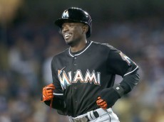 LOS ANGELES, CALIFORNIA - APRIL 28:  Dee Gordon #9 of the Miami Marlins laughs as he returns to the dugout after scoring a run on a balk in the seventh inning against the Los Angeles Dodgers at Dodger Stadium on April 28, 2016 in Los Angeles, California.  (Photo by Stephen Dunn/Getty Images)