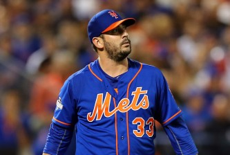 NEW YORK, NY - OCTOBER 12:  Matt Harvey #33 of the New York Mets looks on against the Los Angeles Dodgers during game three of the National League Division Series at Citi Field on October 12, 2015 in New York City.  (Photo by Elsa/Getty Images)