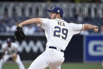 SAN DIEGO, CALIFORNIA - MAY 5:   Colin Rea #29 of the San Diego Padres pitches during the first inning of a baseball game against the New York Mets at PETCO Park on May 5, 2016 in San Diego, California.  (Photo by Denis Poroy/Getty Images)