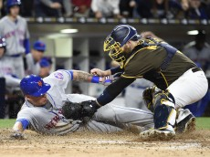 SAN DIEGO, CALIFORNIA - MAY 6: Asdrubal Cabrera #13 of the New York Mets is tagged out at the plate by Derek Norris #3 of the San Diego Padres during the seventh inning of a baseball game at PETCO Park on May 6, 2016 in San Diego, California.  (Photo by Denis Poroy/Getty Images)