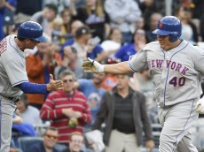 SAN DIEGO, CALIFORNIA - MAY 7:  Bartolo Colon #40 of the New York Mets, right, is congratulated by Tim Teufel #11 after hitting a two-home run home run for the first of his career during the second inning of a baseball game against the San Diego Padres at PETCO Park on May 7, 2016 in San Diego, California.  (Photo by Denis Poroy/Getty Images)
