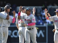 SAN DIEGO, CALIFORNIA - MAY 8: New York Mets players high-five after beating the San Diego Padres 4-3 in a baseball game at PETCO Park on May 8, 2016 in San Diego, California.  (Photo by Denis Poroy/Getty Images)