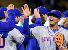 LOS ANGELES, CA - MAY 09:  Juan Lagares #12 of the New York Mets celebrates a 4-2 win over the Los Angeles Dodgers at Dodger Stadium on May 09, 2016 in Los Angeles, California.  (Photo by Harry How/Getty Images)