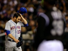 DENVER, CO - MAY 13:  Starting pitcher Matt Harvey #33 of the New York Mets walks faff the field scratching his head after being pulled from the game with two outs in the sixth inning against the Colorado Rockies at Coors Field on May 13, 2016 in Denver, Colorado. (Photo by Justin Edmonds/Getty Images)