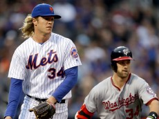 NEW YORK, NY - MAY 17:  Noah Syndergaard #34 of the New York Mets fields a hit by Bryce Harper #34 of the Washington Nationals in the first inning at Citi Field on May 17, 2016 in the Flushing neighborhood of the Queens borough of New York City.  (Photo by Elsa/Getty Images)