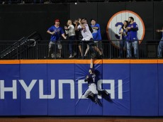 NEW YORK, NY - MAY 20:  Alex Presley #15 of the Milwaukee Brewers cannot catch a two run home run by Michael Conforto #30 of the New York Mets in the sixth inning during their game at Citi Field on May 20, 2016 in New York City.  (Photo by Al Bello/Getty Images)