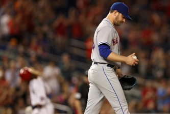 WASHINGTON, DC - MAY 24: Starting pitcher Matt Harvey #33 of the New York Mets looks on after allowing a two run home run by Daniel Murphy #20 of the Washington Nationals (not pictured) during the fifth inning at Nationals Park on May 24, 2016 in Washington, DC. (Photo by Patrick Smith/Getty Images)