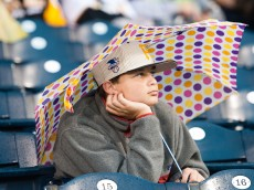 PITTSBURGH, PA - JUNE 06: A young fan sits and watches the scoreboard during a rain delay in the game between the New York Mets and Pittsburgh Pirates at PNC Park on June 6, 2016 in Pittsburgh, Pennsylvania. The game was eventually called due to rain (Photo by Justin Berl/Getty Images)