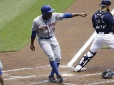 MILWAUKEE, WI - JUNE 09: Curtis Granderson #3 of the New York Mets celebrates after reaching home plate on a RBI single hit by Yoenis Cespedes during the third inning against the Milwaukee Brewers at Miller Park on June 09, 2016 in Milwaukee, Wisconsin. (Photo by Mike McGinnis/Getty Images)