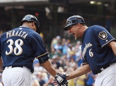 MILWAUKEE, WI - JUNE 11:  Wily Peralta #38 of the Milwaukee Brewers is congratulated by third base coach Ed Sedar #6 following a home run during the fourth inning of a game against the New York Mets at Miller Park on June 11, 2016 in Milwaukee, Wisconsin.  (Photo by Stacy Revere/Getty Images)