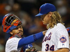 NEW YORK, NY - JUNE 15: Pitcher Noah Syndergaard #34 of the New York Mets gets a pat on the shoulder by catcher Rene Rivera #44 after giving up an RBI double to David Freese of the Pittsburgh Pirates in the ninth inning during a game at Citi Field on June 15, 2016 in the Flushing neighborhood of the Queens borough of New York City. The Mets defeated the Pirates 11-2. (Photo by Rich Schultz/Getty Images)