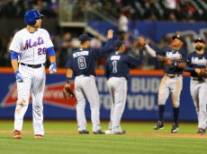 NEW YORK, NEW YORK - JUNE 17:  James Loney #28 of the New York Mets walks off the field after losing to the Atlanta Braves 5-1 at Citi Field on June 17, 2016 in the Flushing neighborhood of the Queens borough of New York City.  (Photo by Mike Stobe/Getty Images)