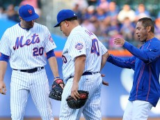 NEW YORK, NEW YORK - JUNE 21:  Bartolo Colon #40 of the New York Mets is attended to after getting injured in the first inning against the Kansas City Royals at Citi Field on June 21, 2016 in the Flushing neighborhood of the Queens borough of New York City.  (Photo by Mike Stobe/Getty Images)