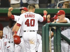 BALTIMORE, MD - JUNE 28:  Wilson Ramos #40 of the Washington Nationals celebrates scoring on Anthony Rendon #6 (not pictured) triple in the second inning during a baseball game against the New York Mets at Nationals Park on June 28, 2016 in Washington, DC.  (Photo by Mitchell Layton/Getty Images)