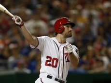WASHINGTON, DC - JUNE 29 : Daniel Murphy #20 of the Washington Nationals hits a two-run home run in the eighth inning against the New York Mets at Nationals Park on June 29, 2016 in Washington, DC. (Photo by Matt Hazlett/Getty Images)