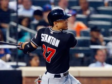 NEW YORK, NY - JULY 05:  Giancarlo Stanton #27 of the Miami Marlins follows through on a seventh inning two run home run against the New York Mets at Citi Field on July 5, 2016 in the Flushing neighborhood of the Queens borough of New York City.  (Photo by Jim McIsaac/Getty Images)