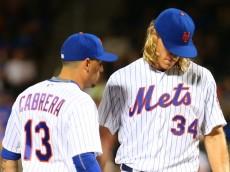 NEW YORK, NEW YORK - JULY 08:  Noah Syndergaard #34 of the New York Mets talks with temmate Asdrubal Cabrera #13 in the fifth inning during a injury timeout against the Washington Nationals at Citi Field on July 8, 2016 in the Flushing neighborhood of the Queens borough of New York City.  (Photo by Mike Stobe/Getty Images)