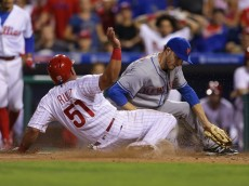 PHILADELPHIA, PA - JULY 16: Carlos Ruiz #51 of the Philadelphia Phillies slides safely into home plate as Erik Goeddel #62 of the New York Mets attempts to make the tag in the eighth inning during a game at Citizens Bank Park on July 16, 2016 in Philadelphia, Pennsylvania. The Phillies won 4-2. (Photo by Hunter Martin/Getty Images)