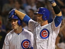 CHICAGO, IL - JULY 18: David Ross #3 of the Chicago Cubs pats teammate Matt Szczur #20 on the head after Szczur scored a run in the 8th inning against the New York Mets at Wrigley Field on July 16, 2016 in Chicago, Illinois. The Cubs defeated the Mets 5-1. (Photo by Jonathan Daniel/Getty Images)