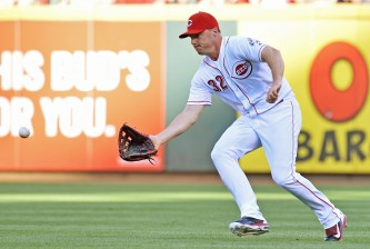 CINCINNATI, OH - JULY 16:  Jay Bruce #32 of the Cincinnati Reds fields a ball in the first inning against the Milwaukee Brewers at Great American Ball Park on July16, 2016 in Cincinnati, Ohio.  (Photo by Jamie Sabau/Getty Images)