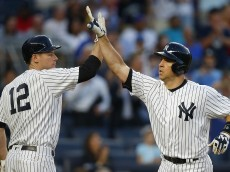 NEW YORK, NY - AUGUST 03: Mark Teixeira #25 of the New York Yankees is congratulated by Chase Headley #12 after he hit a three run home run against the New York Mets during the second inning of a game at Yankee Stadium on August 3, 2016 in the Bronx borough of New York City. (Photo by Rich Schultz/Getty Images)