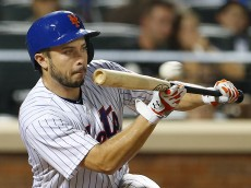 NEW YORK, NY - AUGUST 10: Travis d'Arnaud #18 of the New York Mets attempts to bunt and pops up to first baseman Paul Goldschmidt #44 of the Arizona Diamondbacks in the 10th inning of a game at Citi Field on August 10, 2016 in the Flushing neighborhood of the Queens borough of New York City. The Diamondbacks defeated the Mets 3-2 in 12 innings. (Photo by Rich Schultz/Getty Images)