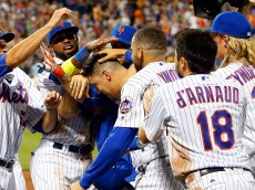 NEW YORK, NY - AUGUST 13:  Wilmer Flores #4 of the New York Mets is mobbed by his teammates after his eleventh inning game winning fielders choice against the San Diego Padres at Citi Field on August 13, 2016 in the Flushing neighborhood of the Queens borough of New York City.  (Photo by Jim McIsaac/Getty Images)