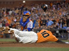 SAN FRANCISCO, CA - AUGUST 19:  Eduardo Nunez #10 of the San Francisco Giants scores as catcher Rene Rivera #44 of the New York Mets can't hold onto the throw in the bottom of the seventh inning at AT&T Park on August 19, 2016 in San Francisco, California.  (Photo by Thearon W. Henderson/Getty Images)