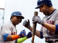 SAN FRANCISCO, CA - AUGUST 21: Yoenis Cespedes #52 of the New York Mets is congratulated by Neil Walker #20 after hitting a two run home run against the San Francisco Giants during the seventh inning at AT&T Park on August 21, 2016 in San Francisco, California.  The New York Mets defeated the San Francisco Giants 2-0. (Photo by Jason O. Watson/Getty Images)