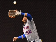 CINCINNATI, OH - SEPTEMBER 6:  Yoenis Cespedes #52 of the New York Mets chases down a fly ball for an out in the ninth inning against the Cincinnati Reds at Great American Ball Park on September 6, 2016 in Cincinnati, Ohio. New York defeated Cincinnati 5-3.  (Photo by Jamie Sabau/Getty Images)