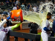 NEW YORK, NY - SEPTEMBER 17:  Curtis Granderson #3 of the New York Mets is doused with Gatorade after his twelfth inning game winning home run against the Minnesota Twins by teammate Yoenis Cespedes #52 at Citi Field on September 17, 2016 in the Flushing neighborhood of the Queens borough of New York City.  (Photo by Jim McIsaac/Getty Images)
