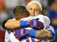 NEW YORK, NEW YORK - SEPTEMBER 22:  Asdrubal Cabrera #13 of the New York Mets celebrates with Yoenis Cespedes #52 after hitting a game winning walk-off three run home run in the bottom of the twelfth inning against the Philadelphia Phillies at Citi Field on September 22, 2016 in the Flushing neighborhood of the Queens borough of New York City.  (Photo by Mike Stobe/Getty Images)
