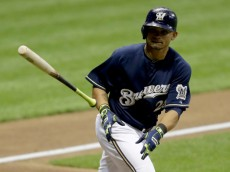 MILWAUKEE, WI - AUGUST 06:  Gerardo Parra #28 of the Milwaukee Brewers throws his bat after drawing a walk in the bottom of the third inning against the San Francisco Giants at Miller Park on August 06, 2014 in Milwaukee, Wisconsin. (Photo by Mike McGinnis/Getty Images)