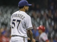 Milwaukee Brewers' Francisco Rodriguez looks on after giving up a two-run home run to Cincinnati Reds' Joey Votto during the ninth inning of a baseball game Saturday, Aug. 29, 2015, in Milwaukee. (AP Photo/Tom Lynn)  ORG XMIT: WITL111