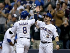 MILWAUKEE, WI - APRIL 8:  Scooter Gennett #2 congratulates Ryan Braun #8 of Milwaukee Brewers after Braun hit a home run during the eighth inning against the Houston Astros during the game at Miller Park April 8, 2016 in Milwaukee, Wisconsin. (Photo by Dylan Buell/Getty Images)