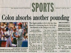 colon-pounding-newspaper