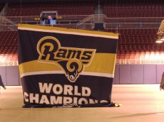Decoraters wait for the St. Louis Rams Super Bowl banner to lower from the rafters of the Edward Jones Dome in St. Louis on January 14, 2016. Signage is being removed from the former home of the St. Louis Rams after owner Stan Kroenke announced the team will return to Los Angeles for the 2016 season and will eventually play in a new stadium. The Rams arrived in St. Louis from Los Angeles in 1995, winning the Super Bowl in 2000, but in recent years have had the lowest attendance in the NFL.  Photo by Bill Greenblatt/UPI