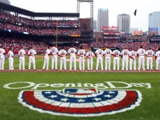 The St. Louis Cardinals stand for the National Anthem while an American Bald Eagle flys around Busch Stadium before a game against the Cincinnati Reds on Opening Day in St. Louis on April 7, 2014. UPI/Bill Greenblatt
