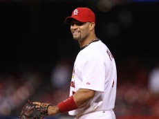 St. Louis Cardinals Albert Pujols laughs to teammates in the dugout as third baseman Felipe Lopez tries his hand at pitching to the New York Mets in the 18th inning at Busch Stadium in St. Louis on April 17, 2010. New York won the game 2-1 in 20 innings.     UPI/Bill Greenblatt