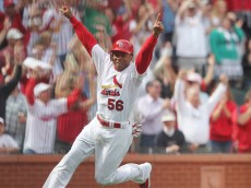 St. Louis Cardinals Adron Chambers celebrates a game winning wild pitch by Chicago Cubs Carlos Marmol as he crosses home plate in the ninth inning at Busch Stadium in St. Louis on September 24, 2011. St. Louis won the game 2-1. UPI/Bill Greenblatt