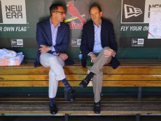 ST. LOUIS, MO - SEPTEMBER 29: St. Louis Cardinals general manager John Mozeliak (L) and Bill DeWitt, Jr. managing partner and chairman of the St. Louis Cardinals talk in the dugout prior to a game against the Chicago Cubs at Busch Stadium on September 29, 2013 in St. Louis, Missouri.  The Cardinals beat the Cubs 4-0.  (Photo by Dilip Vishwanat/Getty Images)